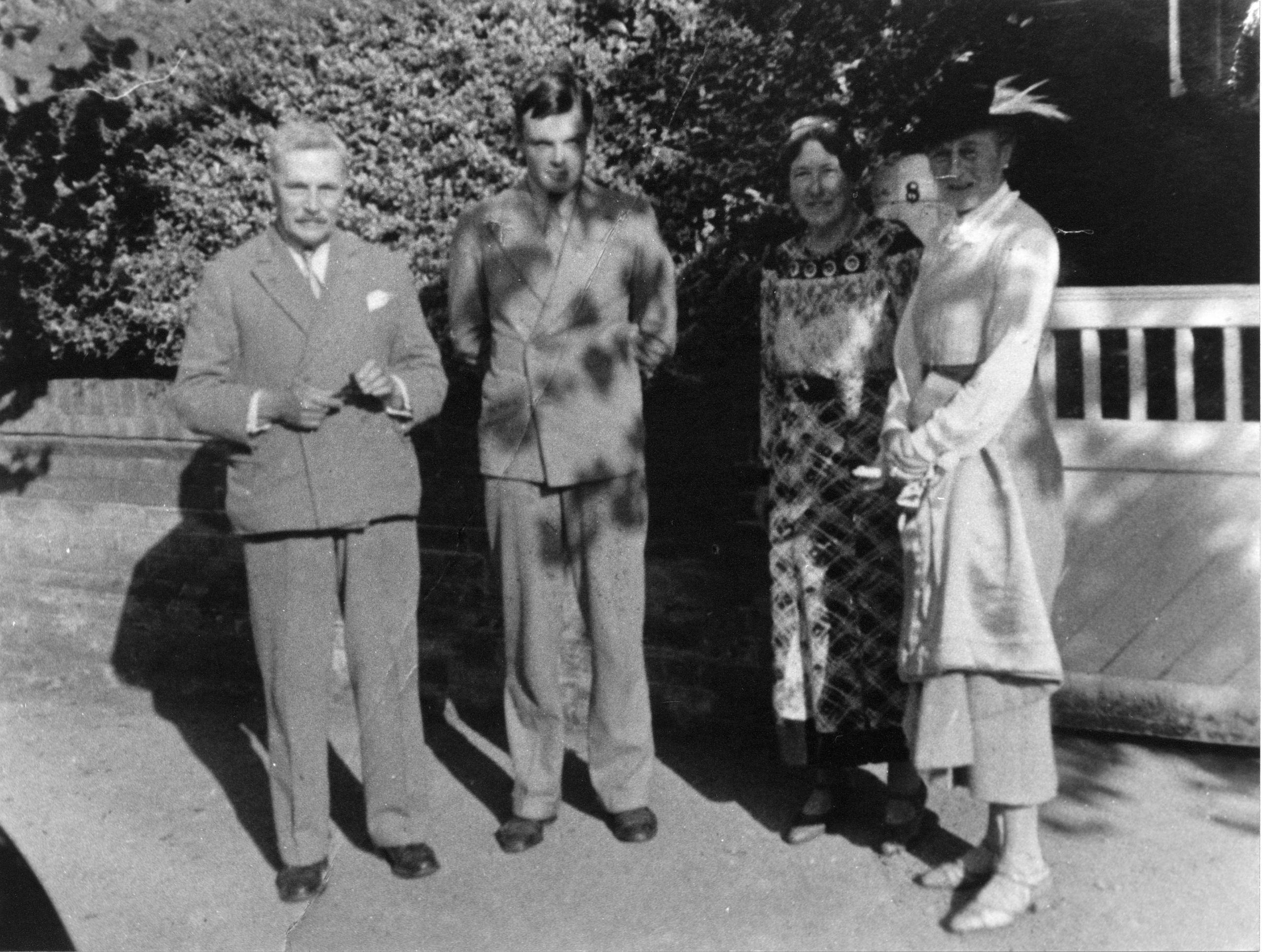 Turing with his parents and an unknown friend of the family standing outside his parents' house. [AMT/K/7/34]
