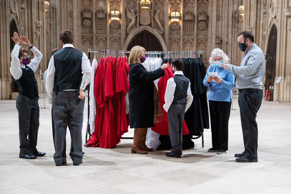 The choristers being fitted with robes