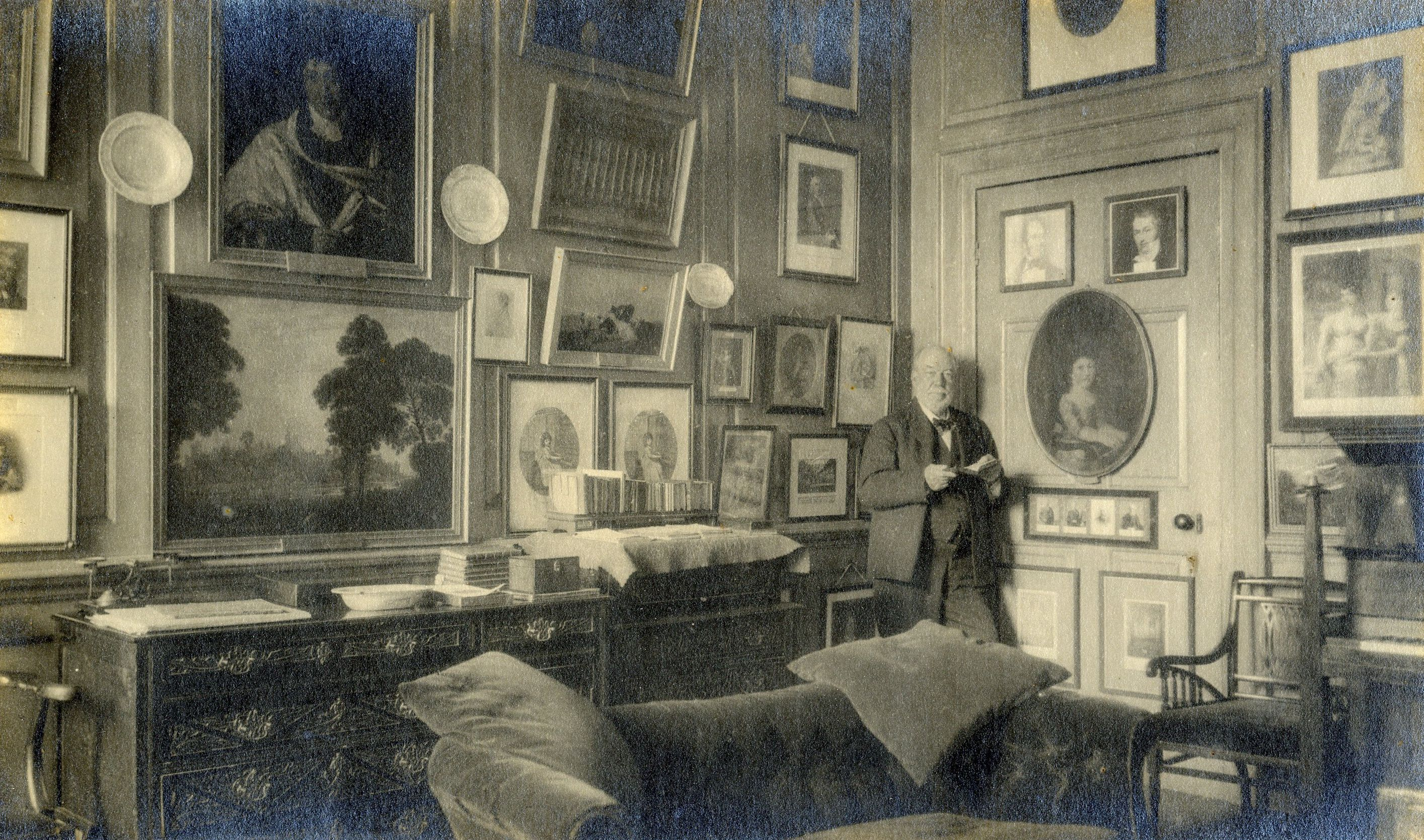 Arthur Henry 'Daddy' Mann in his rooms. [Coll Ph 6]