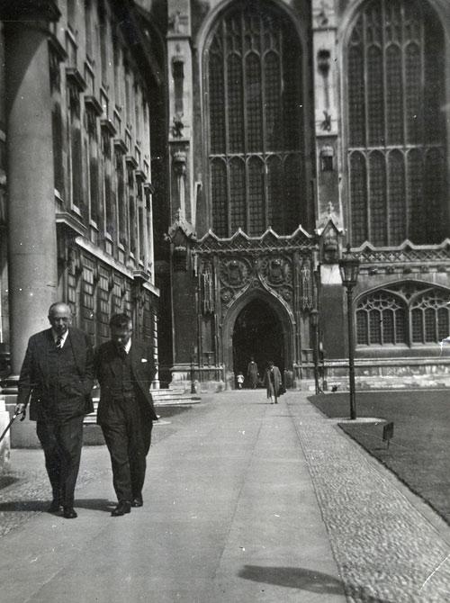 John Saltmarsh (right) and Boris Ord walking along the Gibbs Building away from the Chapel.  (Coll Photo 102)
