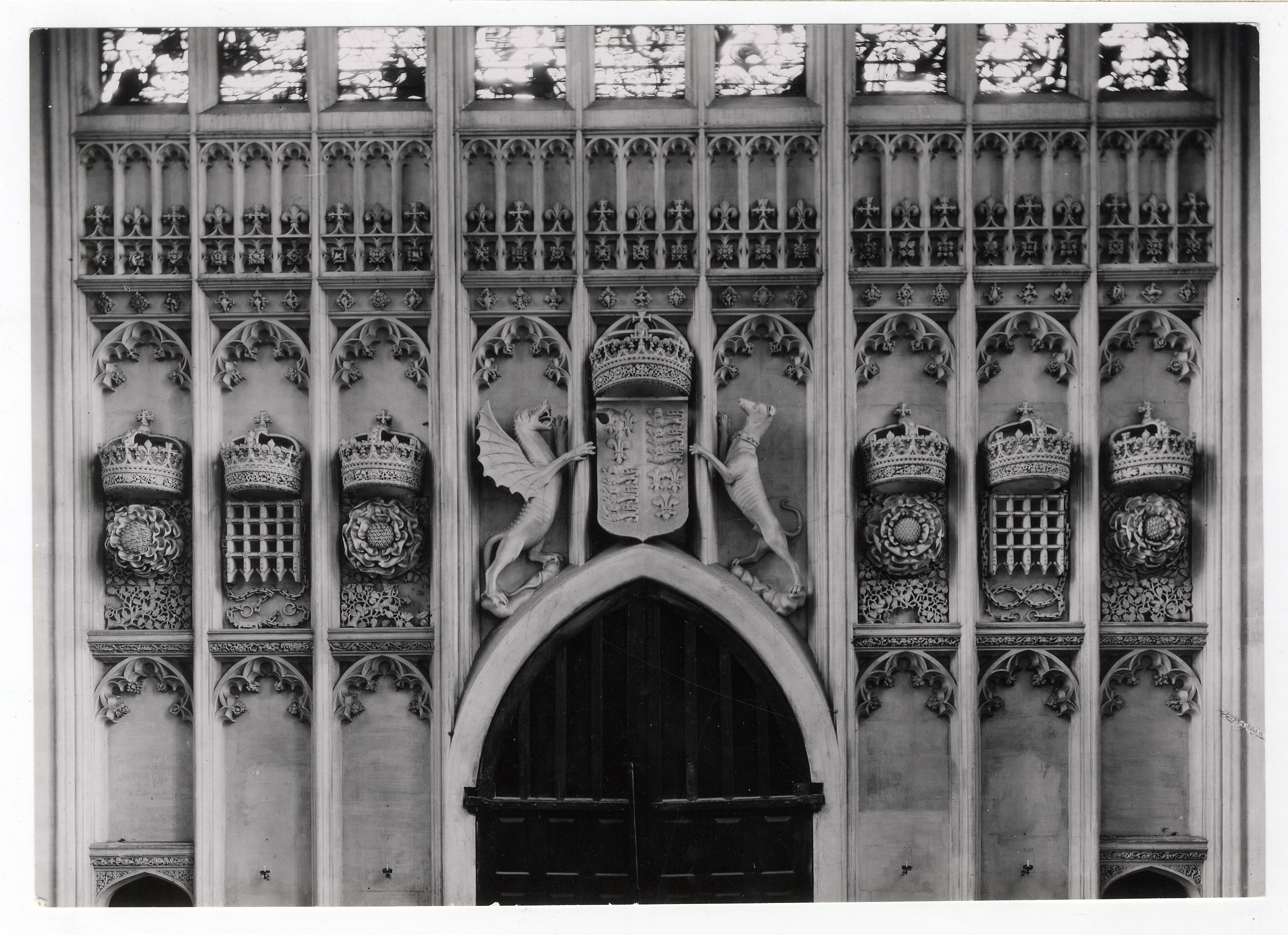 Heraldic carvings on the walls of the antechapel. Photograph: RCHM, 1949. [Coll-Ph-836].