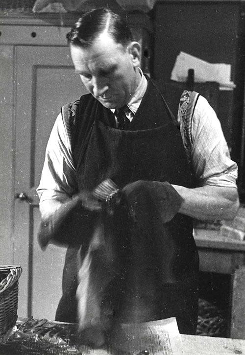 A. Childerley polishing silver