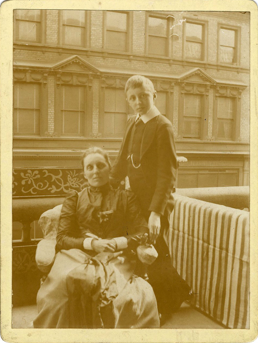 E.M. Forster standing on a balcony beside Alice Clara Forster, possibly taken at Whitstable (EMF/27/163).