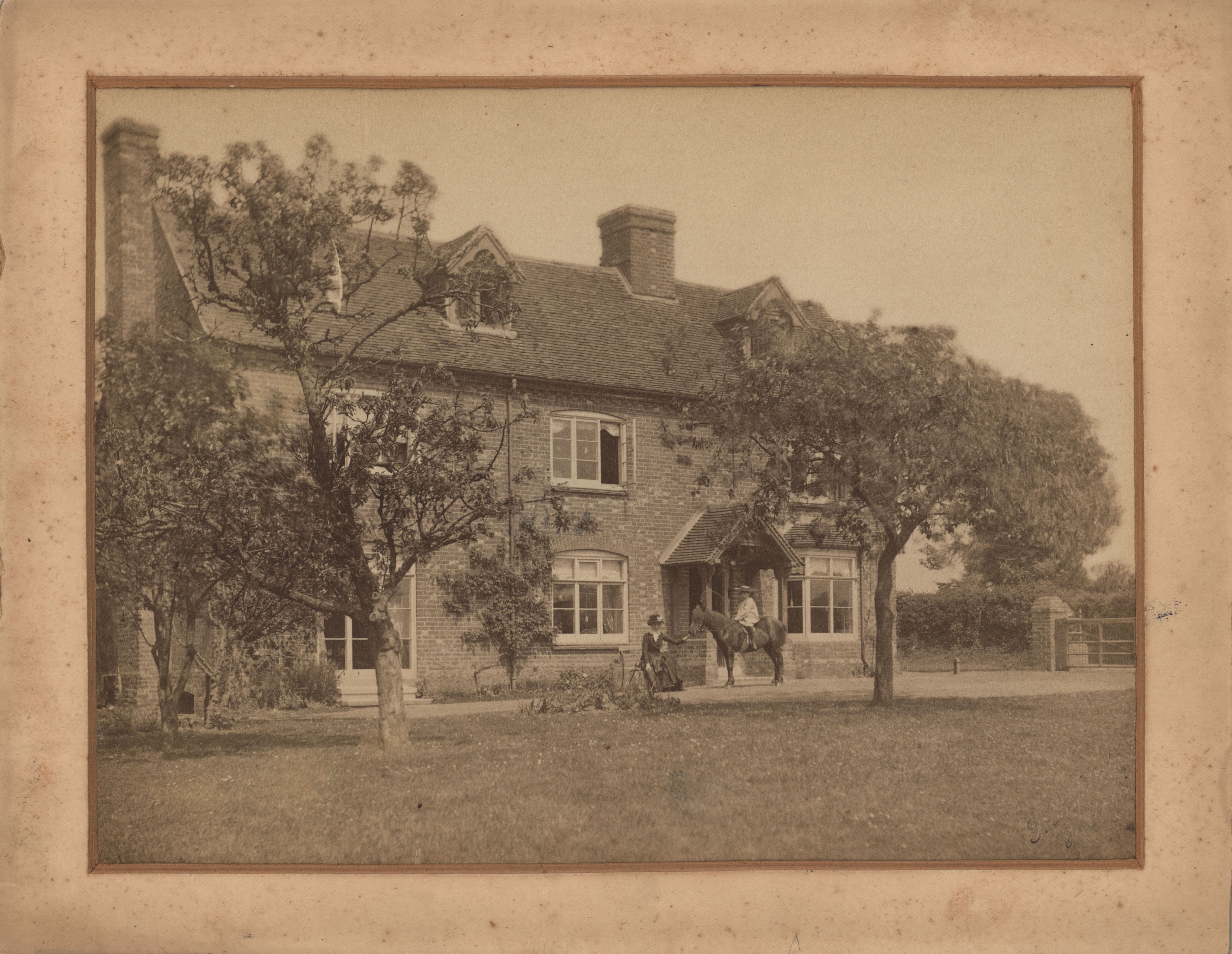 Photograph of Rooksnest showing a young Forster with his mother. [EMF/27/180]
