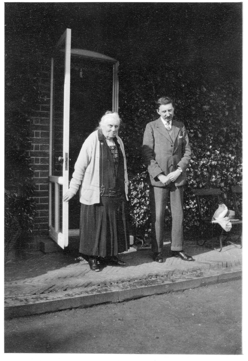 Alice Clara Forster, in old age, and E.M. Forster standing outside their house at West Hackhurst, Abinger, Surrey (EMF/27/381).
