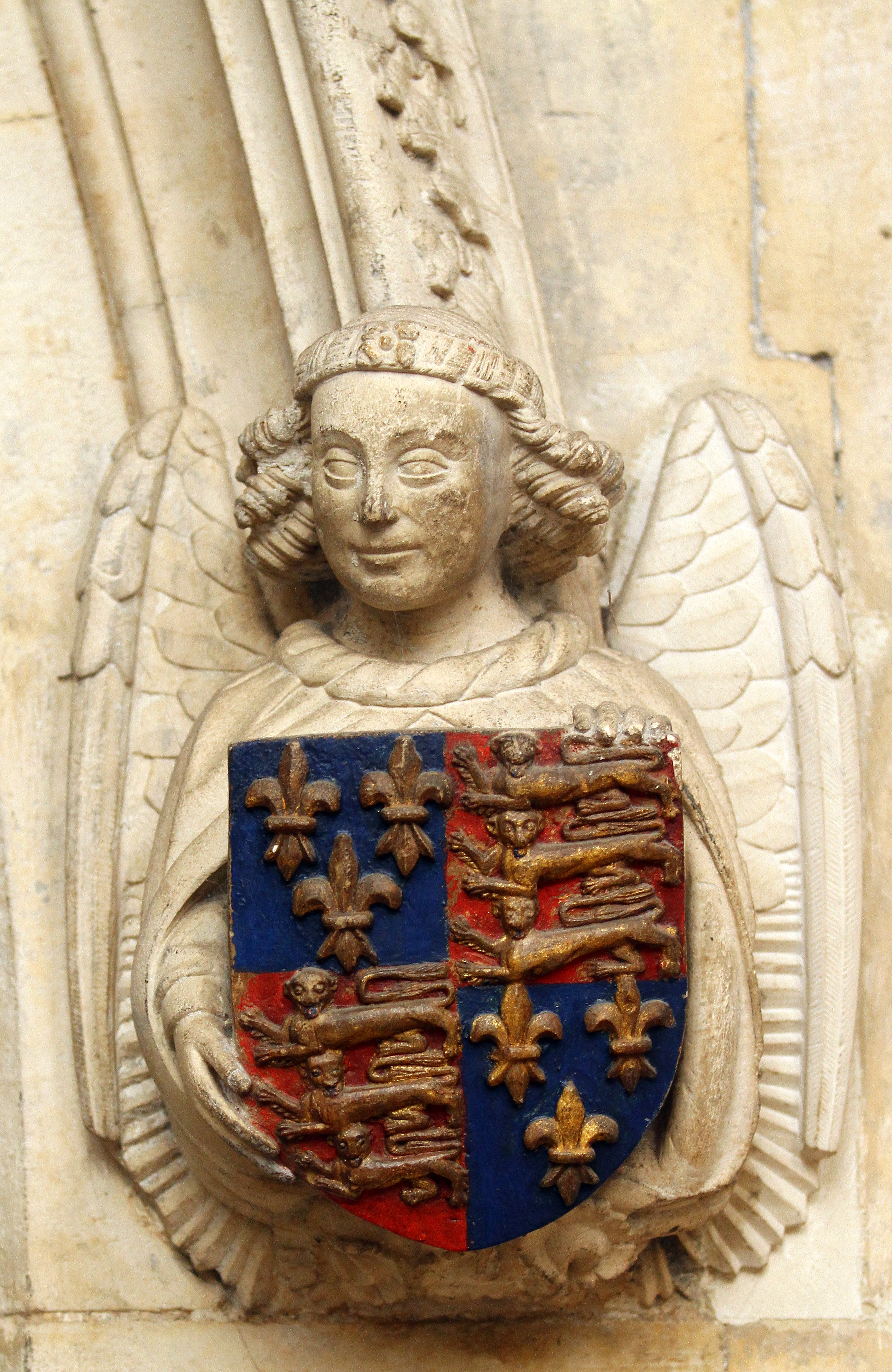 Royal arms borne by an angel by the north Choir doorway. Photograph © Mike Dixon 2011 King's College, Cambridge [CMR/250, IMG_5497]