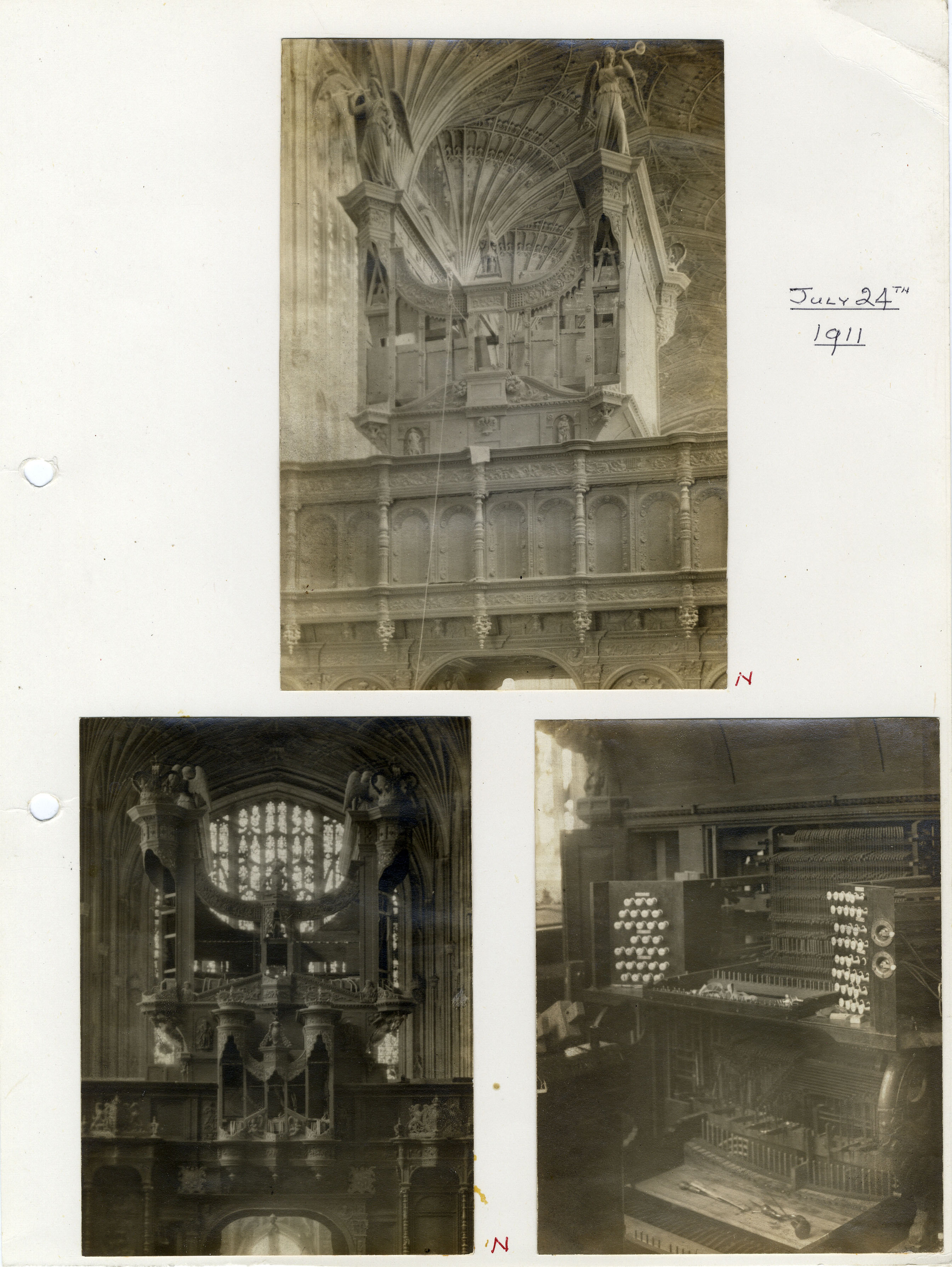 The organ being repaired in 1911. The angels had reappeared by then and the case had been enlarged. (KCC/615)