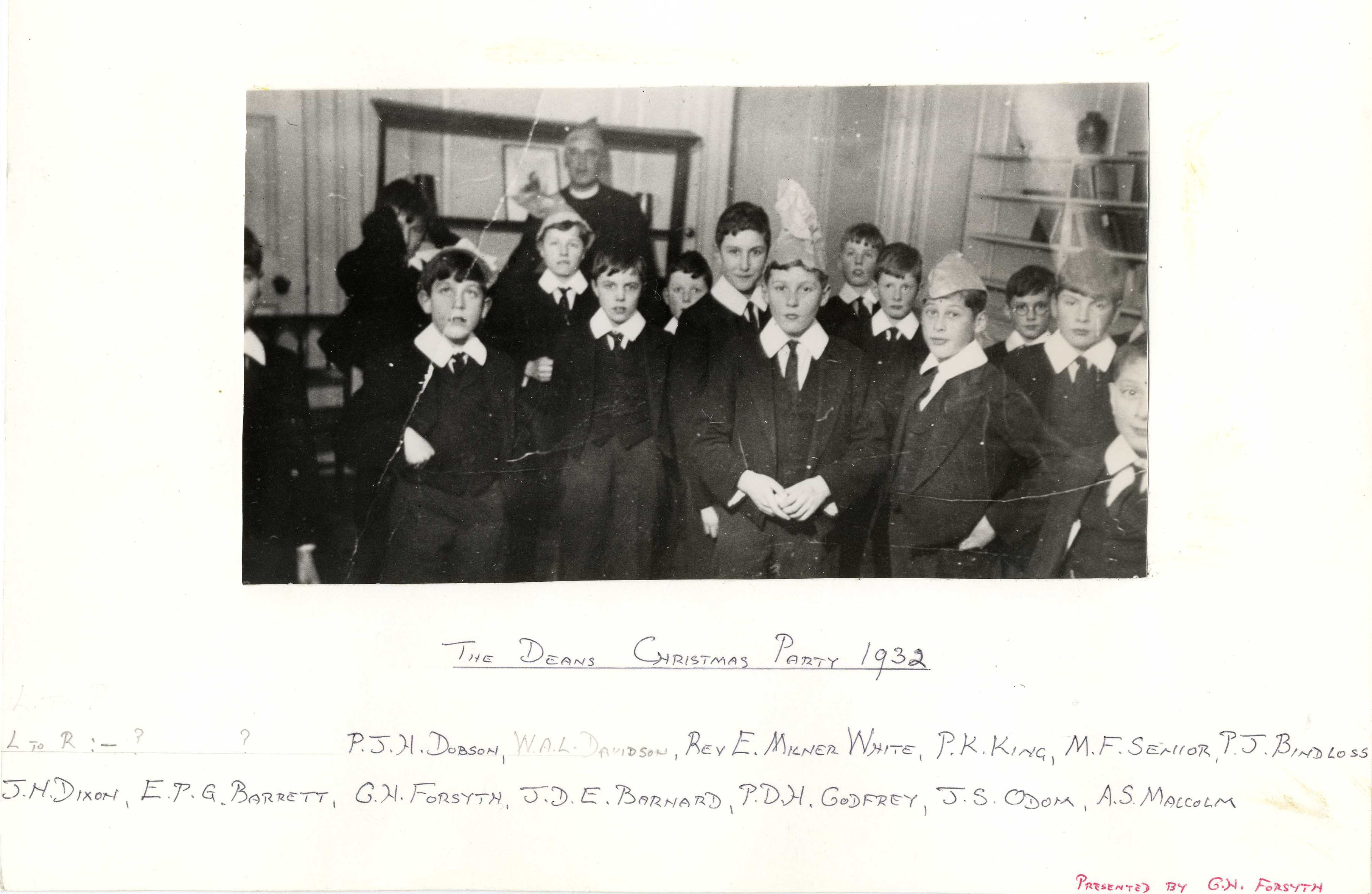 The Dean's Christmas Party, 1932, showing Milner-White at the back. (KCPH/2/2/2/10, presented by G.H. Forsyth)