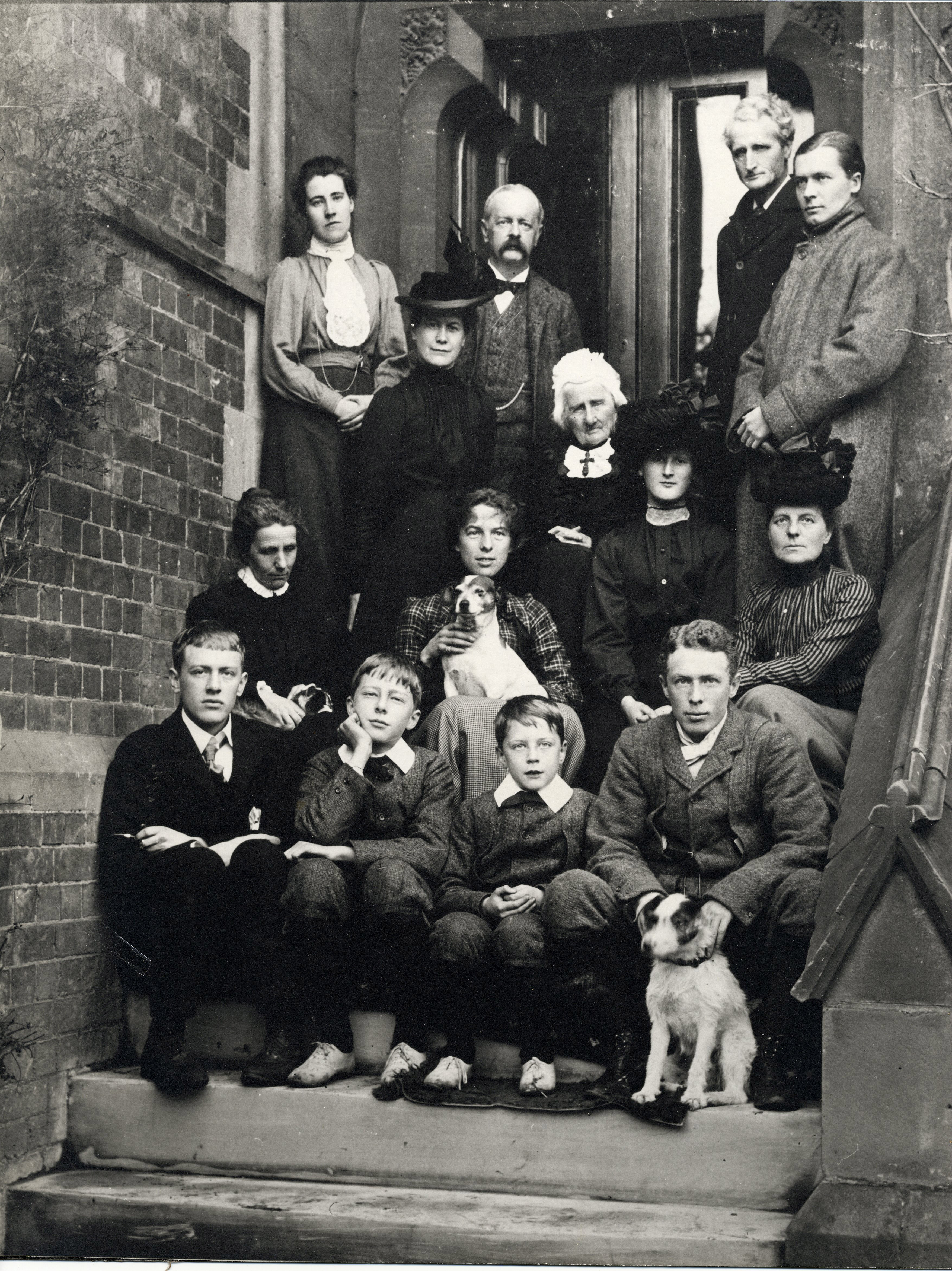 Group photograph of the Brooke and Cotterill families on steps outside house.  Rupert in the centre of the front row (RCB/Ph/9)