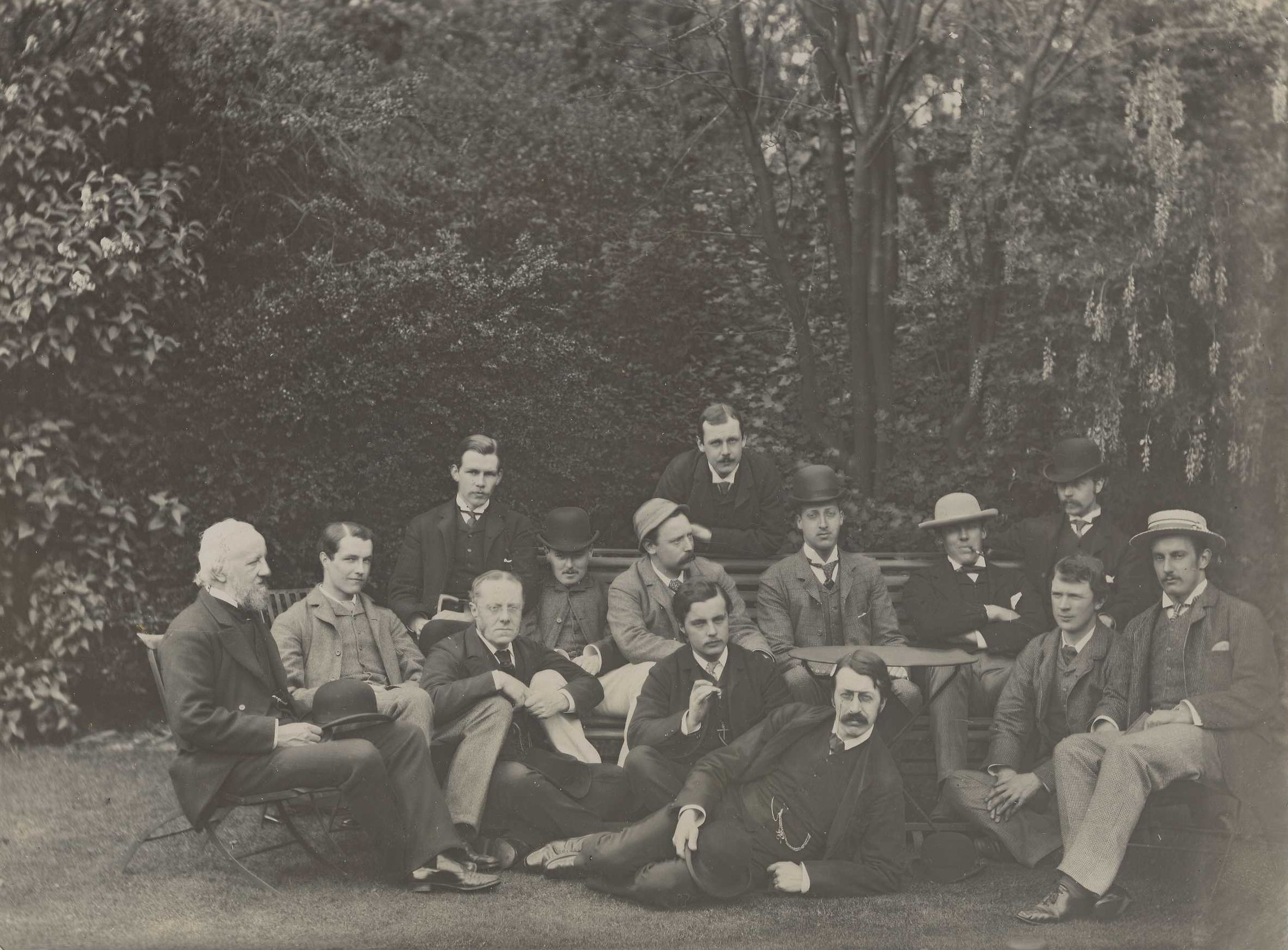 Apostles group photo, c.1883. J.K. Stephen (KC1878) is wearing a hat and smoking a pipe. [KCAS/39/4/1]