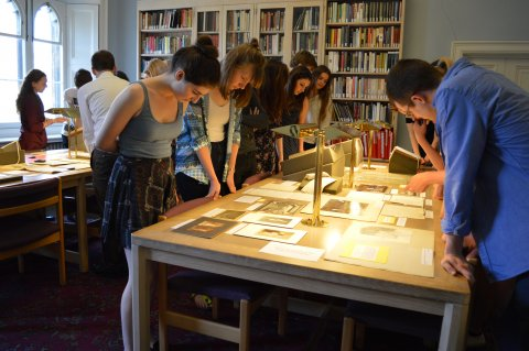 Students viewing an exhibition of Rupert Brooke papers.