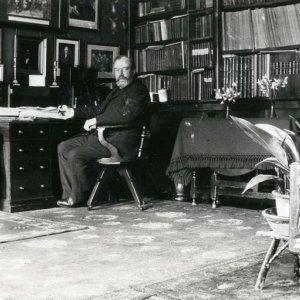 Arthur Henry Mann (KC 1876; organist) in his College room (taken by JRW Hughes, c.1914; AHM/5/2/3)