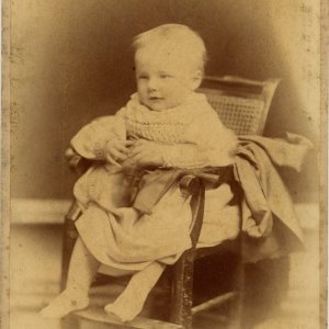 Professional studio portrait of Rupert Brooke as a baby, in 1888. Photographer: E.H. Speight, Rugby. [RCB/Ph/1]
