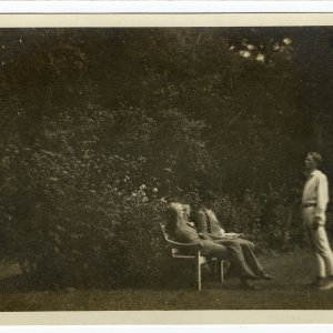 Rupert Brooke reciting (or possibly rehearsing his role of Mephistophiles in Doctor Faustus) to Dudley Ward and Jacques Raverat. Taken at the Old Vicarage garden, Grantchester.  1907.   [RCB/Ph/132]