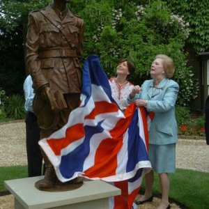 •Photograph of Lady Thatcher unveiling the sculpture of Rupert Brooke in front of the Old Vicarage, Grantchester, 11 June 2006. Courtesy of Dame Mary Archer.